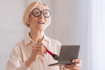 Surprised mature woman looking forward