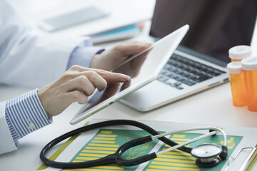 Doctors are working with tablets in the medical office