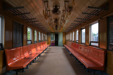 Old abandoned seats in old tram whole view