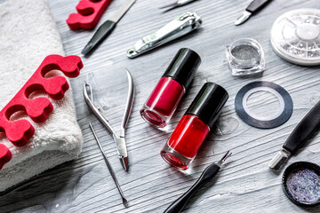 manicure set and nail polish for hands treatment on wooden background