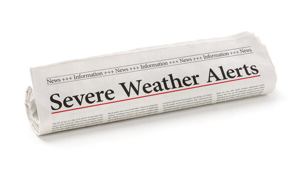 Rolled newspaper with the headline Severe Weather Alerts