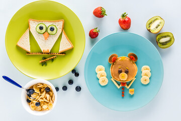 flat lay with creatively styled children's breakfast with berries and kiwi
