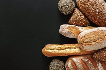 Bakery concept. Plenty of bread background isolated on balck