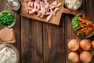 Ingredients for preparing omelette with bacon and vegetables