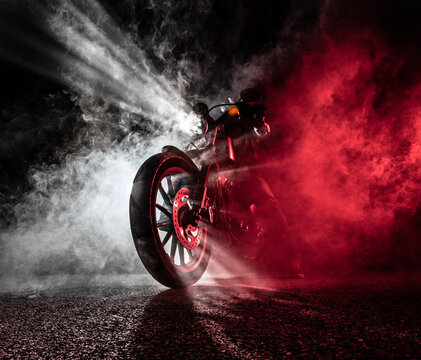 High power motorcycle chopper at night.