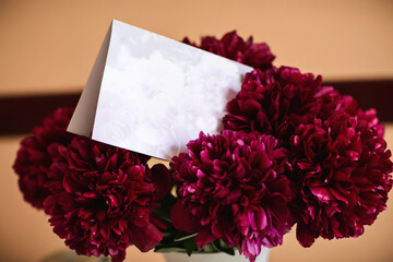 Wedding invitation in bouquet of flowers, card with copy space
