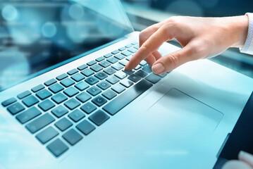 Closeup of hand using computer keyboard. Closeup of businesswoman hand using computer laptop keyboard