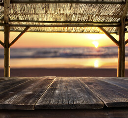 empty bar table against sunset at the beach