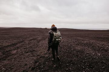 Tourist walking in desert