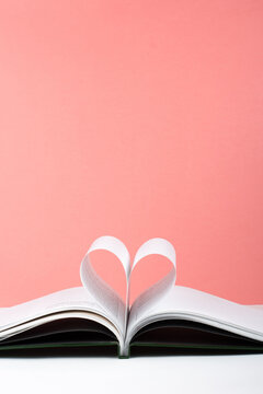 Old open hardback book, page decorate into a heart shape for love in Valentine's. love with open book heart.
