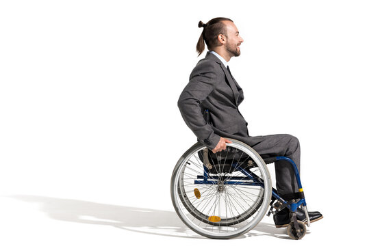 side view of smiling disabled businessman in wheelchair isolated on white