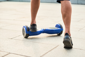 Male legs and gyroscooter. Blue two wheel scooter.