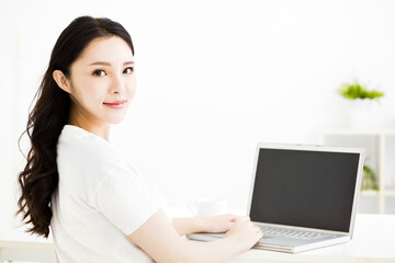 beautiful young smiling woman  with laptop