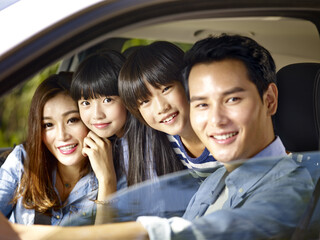 asian family riding in a car