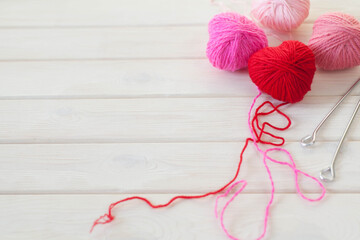 warm hearts made of red and pink wool yarn