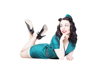 Portrait of Cute Sexy Brunette with black hair. Pin up Female Dressed in military clothing Uniform and Garrison cap with legs in the air. Army Pin-up Girl Concept