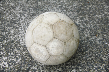 Stock Photo - Old soccer ball on concrete floor (street soccer)