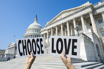 Hands of political protesters holding signs of the positive message CHOOSE LOVE in front of the Capitol Building in Washington DC, USA