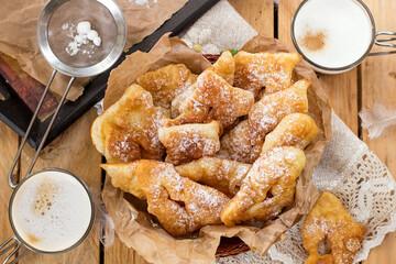 Sweet crisp pastry Angel wings with powdered sugar