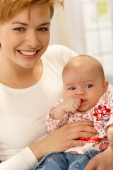 Closeup portrait of beautiful young mum and baby