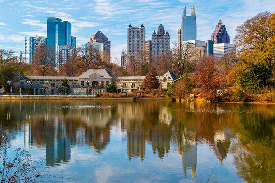View of Lake Clara Meer, Piedmont Park Aquatic Center and Midtown Atlanta in sunny autumn day, USA.