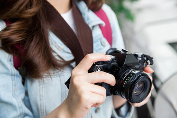 Camera in woman hand