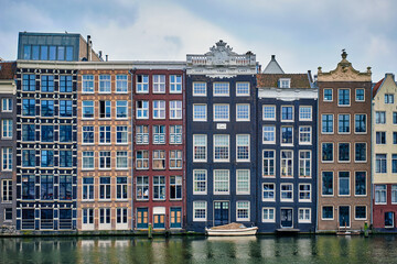 Amsterdam canal Damrak with houses, Netherlands