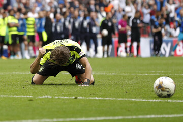 Huddersfield Town's Michael Hefele looks dejected after having his penalty saved during the shootout