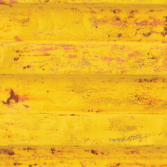 Yellow sea freight container background rusty corrugated pattern, horizontal rusted detailed steel texture cracked grungy metal paint detail, old aged weathered textured rust grunge copy space closeup