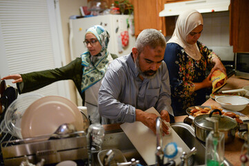 Egyptian American Muslim family members cook and clean ahead of breaking fast during Ramadan in New Jersey