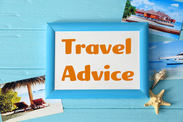 Concept of tourism. Frame with text TRAVEL ADVICE and photos on wooden background