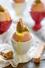 Soft boiled eggs and whole grain toast bread,selective focus
