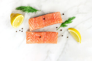 Photo of slices of salmon on white with copyspace