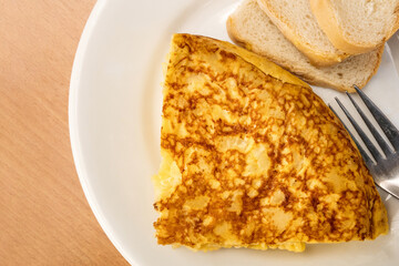 Slice of Spanish tortilla, potato omelette, served as tapas