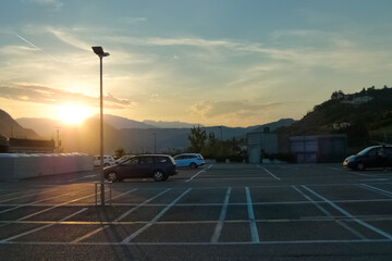 Rooftop outdoor parking lot against sunset