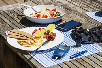 Diabetes blood sugar testing devices with a healthy meal.