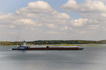 Towboat pushing cargo barges on the river.