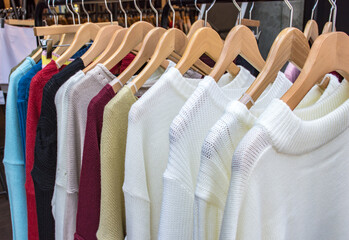 Colorful women's clothes hanging on a rack