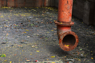 Colorful tube on dark sewage with dirty water