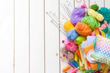 Colored fabric, yarn, thread, crayons and paints. Colored materials for creative work on the table. Do needlework. Everything for handmade.
