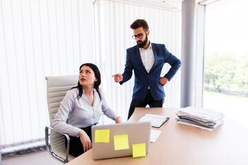 Businesswoman listening her boss complaining about work