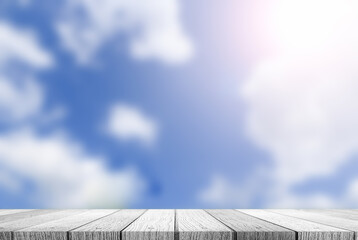 Empty top of wooden table and view of blur blue sky background