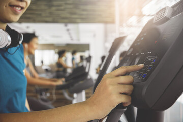 Closeup woman hand using exercise bike at the gym.