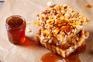 Caramel tart with nuts, maple syrup and honey.