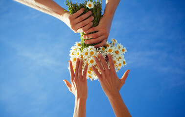 bouquet with lovers couple. Family concept. Flowers concept. Spring day. Love story. Love concept. Sky blue background.