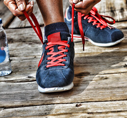 Concept: healthy lifestyle, Running shoes - closeup of woman tying shoe laces. Female sport fitness runner getting ready for jogging