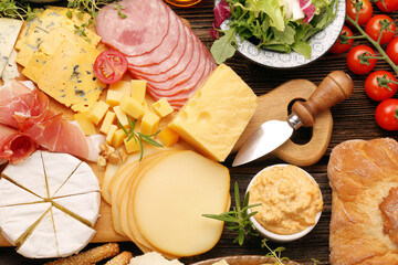 buffet of various types of cheese and appetizers set
