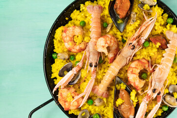 Closeup of Spanish seafood paella in paellera with copyspace