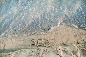 Inscription on the sand - Sea near the black sea.