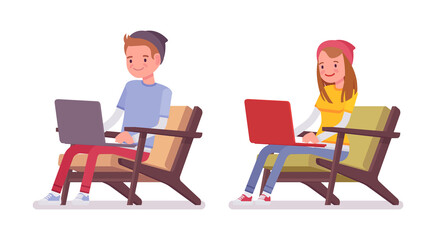Teenager boy and girl sitting with laptop
